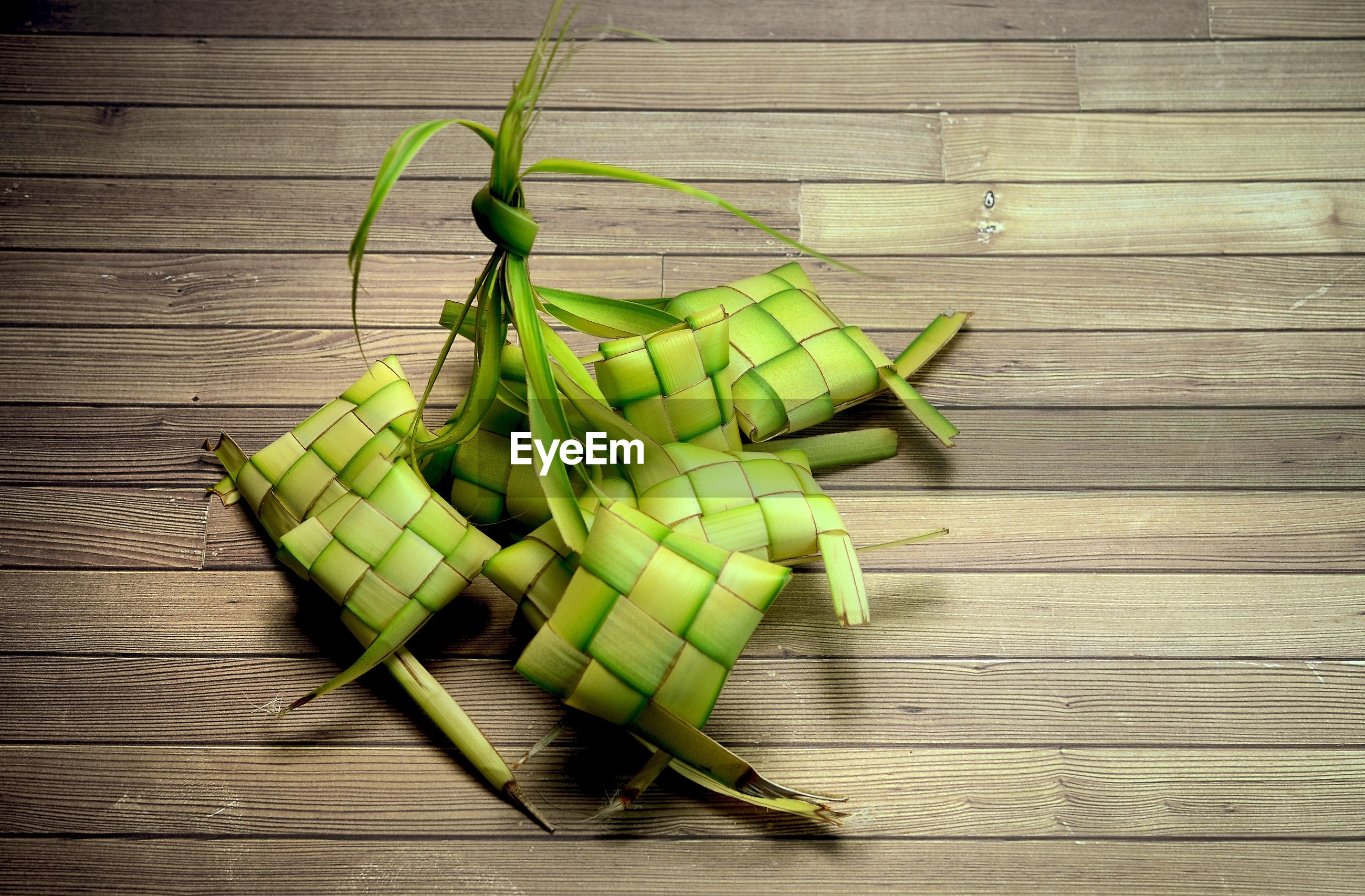 High angle view of ketupat casing on table background