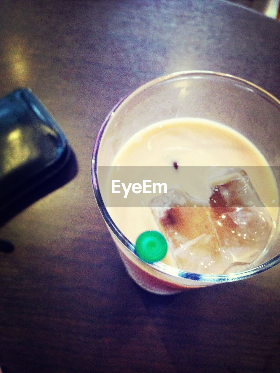 table, food and drink, drink, indoors, refreshment, ice cube, drinking glass, iced coffee, cold temperature, no people, high angle view, close-up, freshness, drinking straw, food, sweet food, ready-to-eat, day
