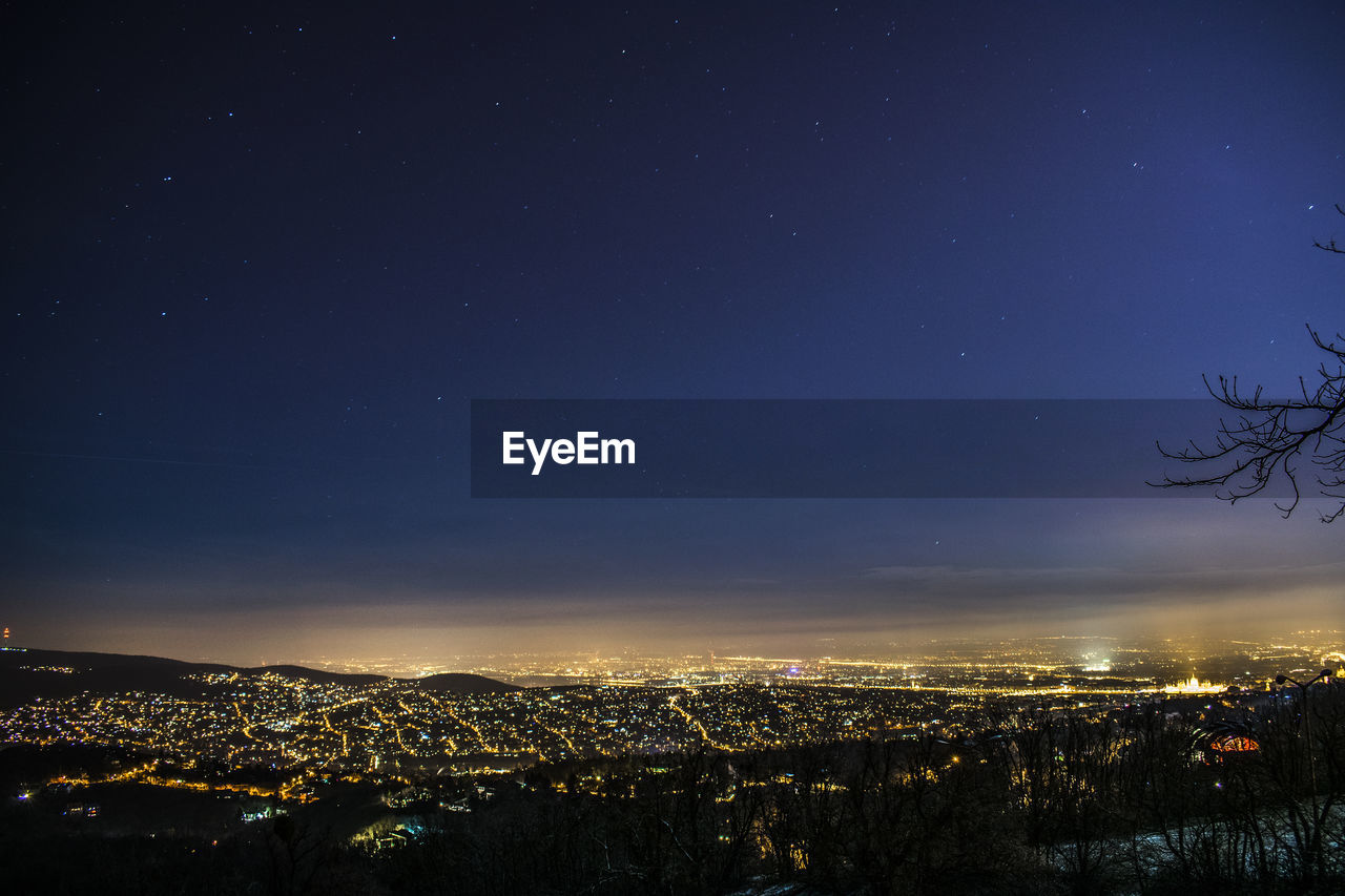 building exterior, architecture, night, sky, cityscape, city, built structure, star - space, nature, building, residential district, crowd, space, astronomy, illuminated, crowded, scenics - nature, outdoors, blue, townscape