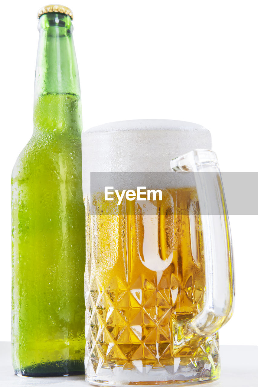 food and drink, container, drink, refreshment, white background, indoors, still life, glass - material, bottle, freshness, close-up, no people, studio shot, transparent, food, glass, table, drinking glass, alcohol, non-alcoholic beverage