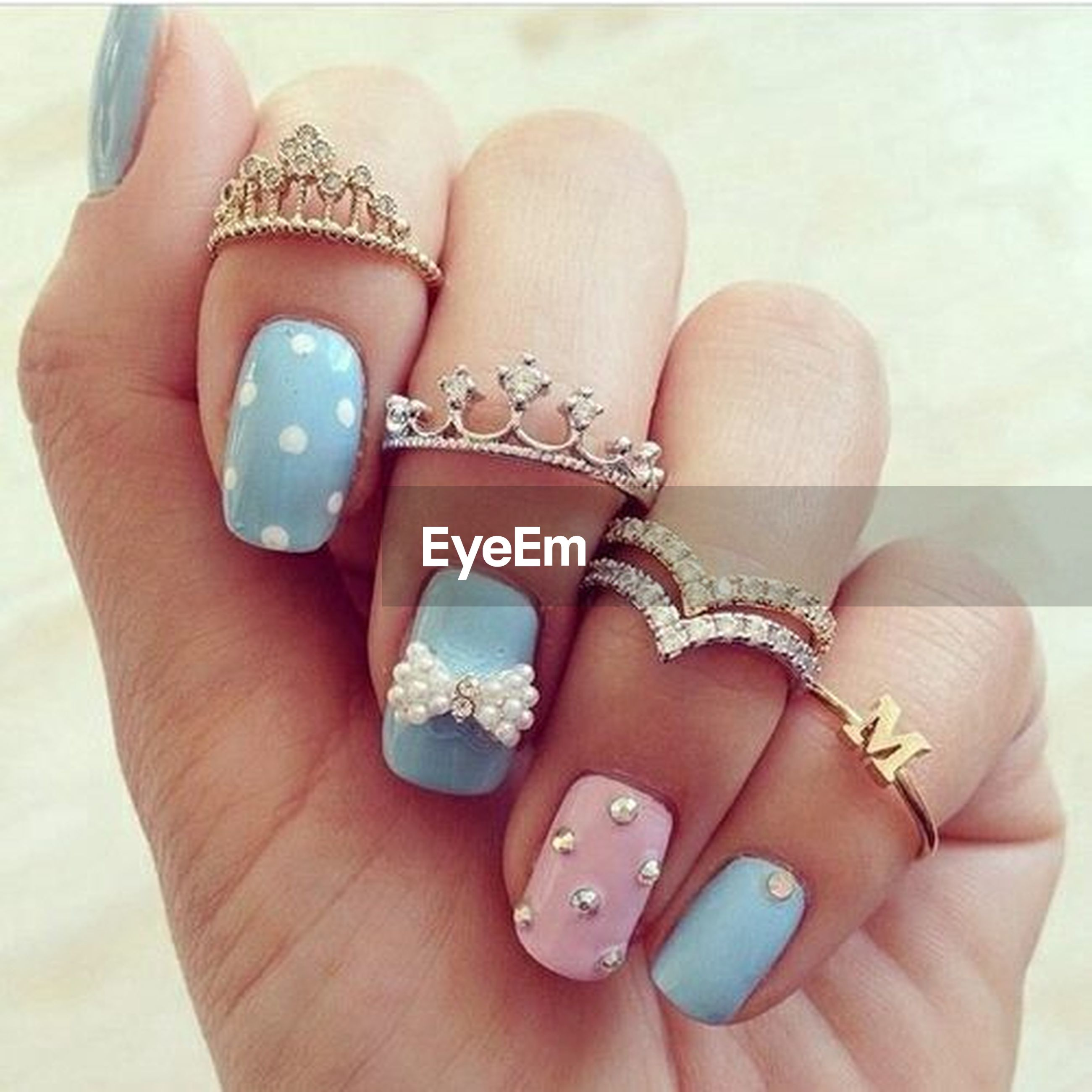 person, part of, close-up, personal perspective, indoors, human finger, fashion, jewelry, high angle view, holding, lifestyles, nail polish, leisure activity, ring, bracelet, unrecognizable person
