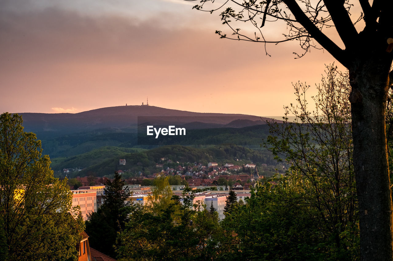 Scenic View Of Townscape Against Sky At Sunset