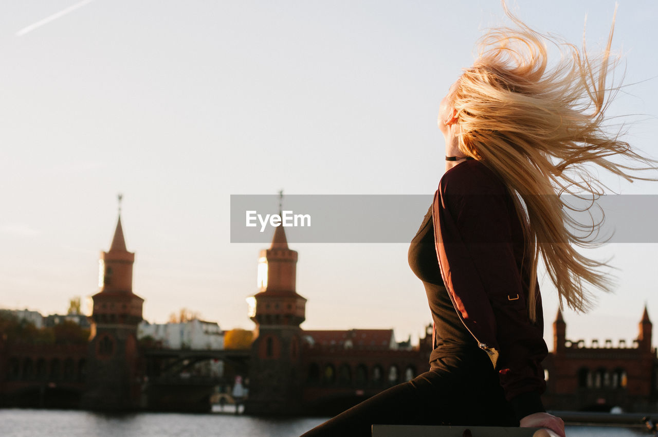 Rear View Of Young Woman By River