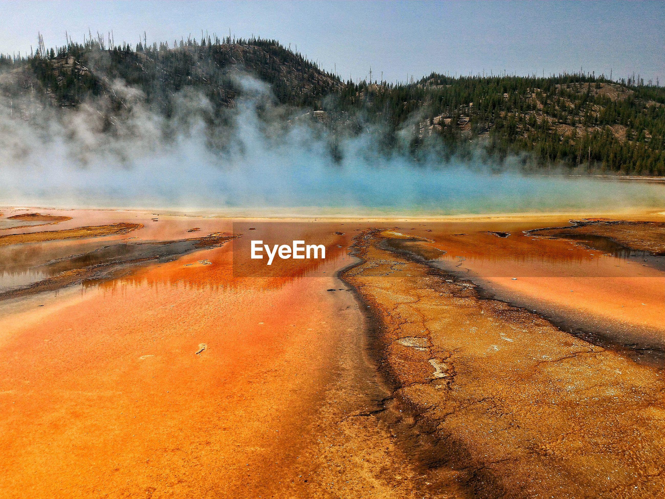 Idyllic shot of smoke in hot spring at yellowstone national park