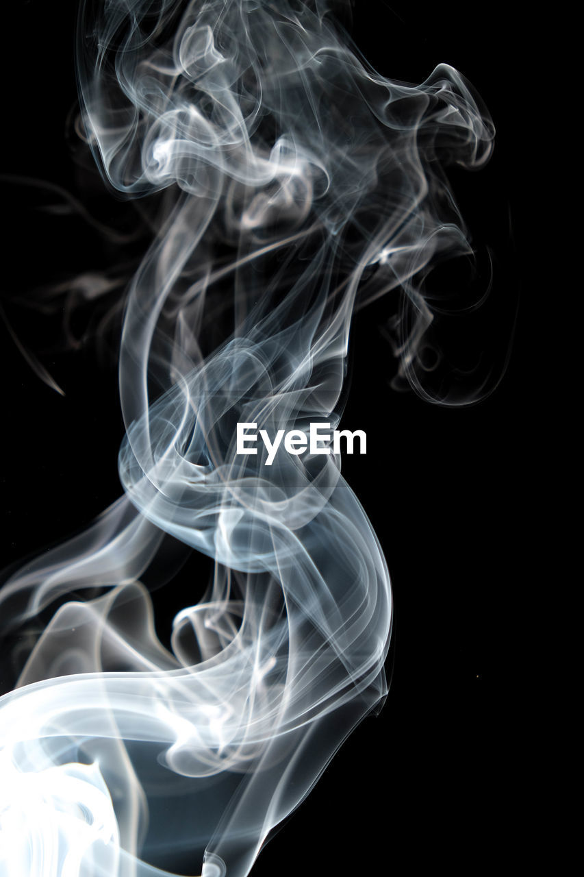 black background, studio shot, smoke - physical structure, motion, indoors, close-up, no people, swirl, pattern, abstract, incense, white color, nature, natural pattern, design, burning, moving up, changing form, curve, vulnerability, fumes, luminosity