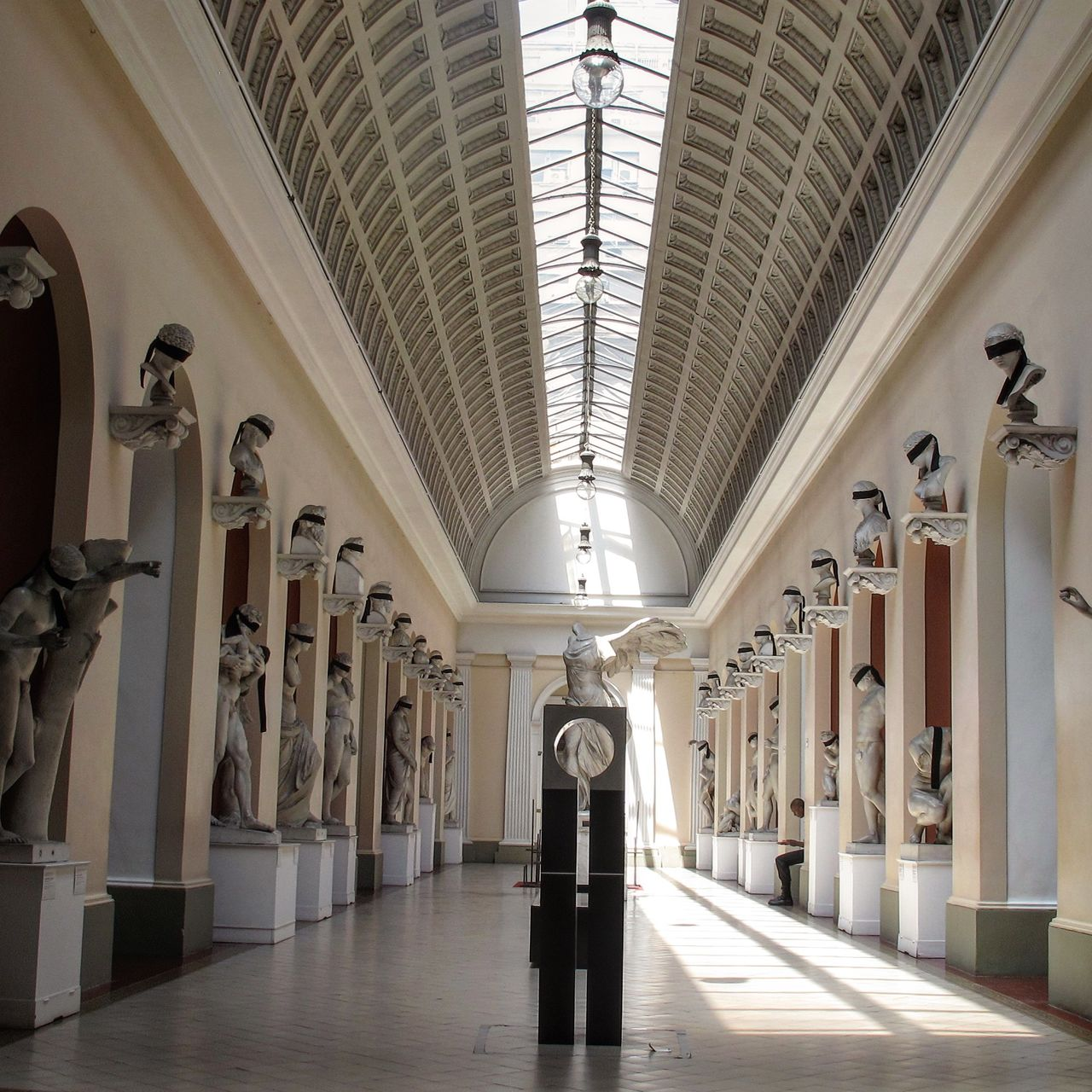 architectural column, indoors, arch, architecture, history, one person, full length, real people, museum, travel destinations, day, people