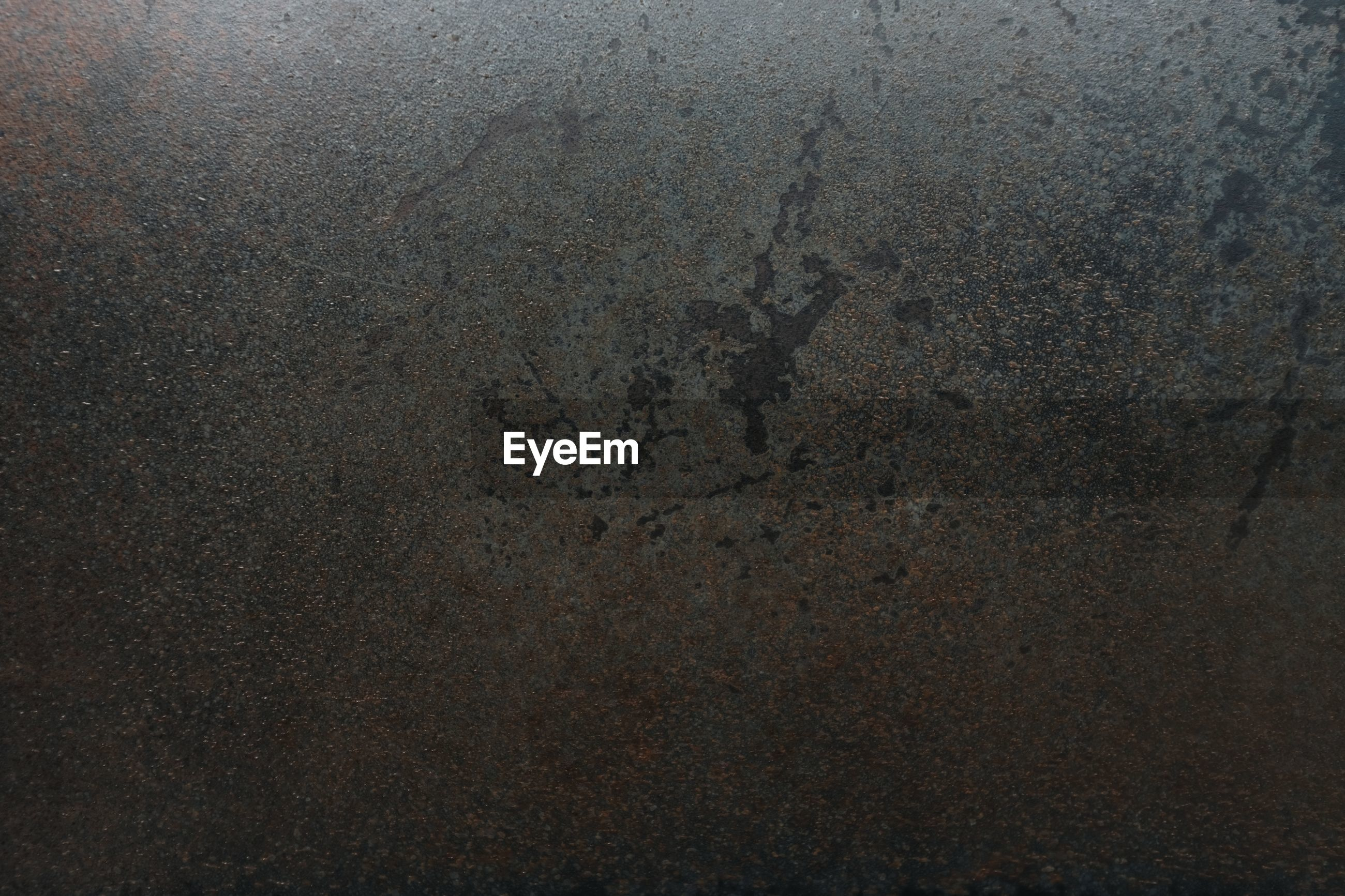 Old black metal background and rust stains