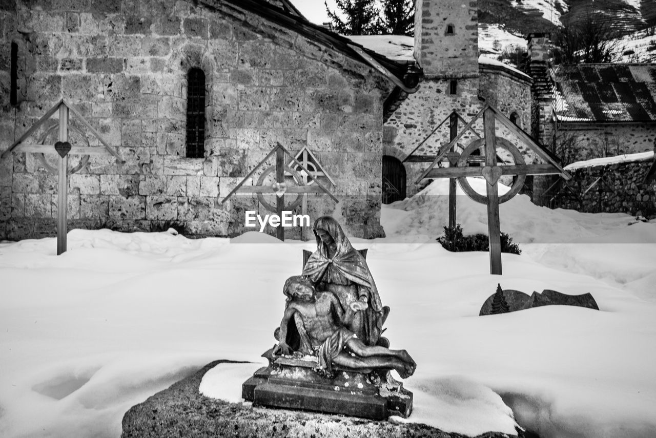snow, cold temperature, winter, architecture, built structure, representation, sculpture, human representation, building exterior, art and craft, no people, statue, day, building, nature, religion, spirituality, male likeness, belief, snowing