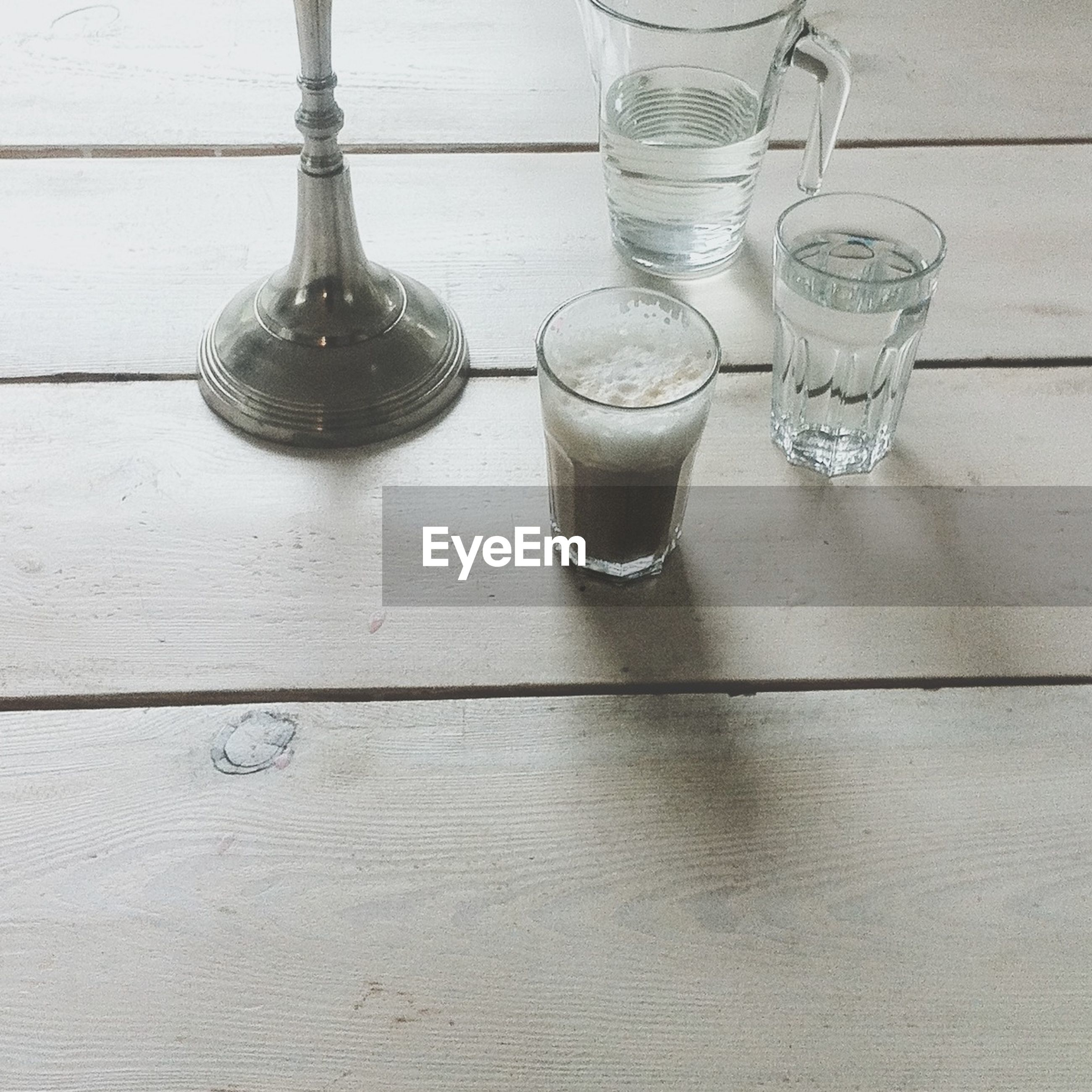 Close-up of drink with glass of water on table