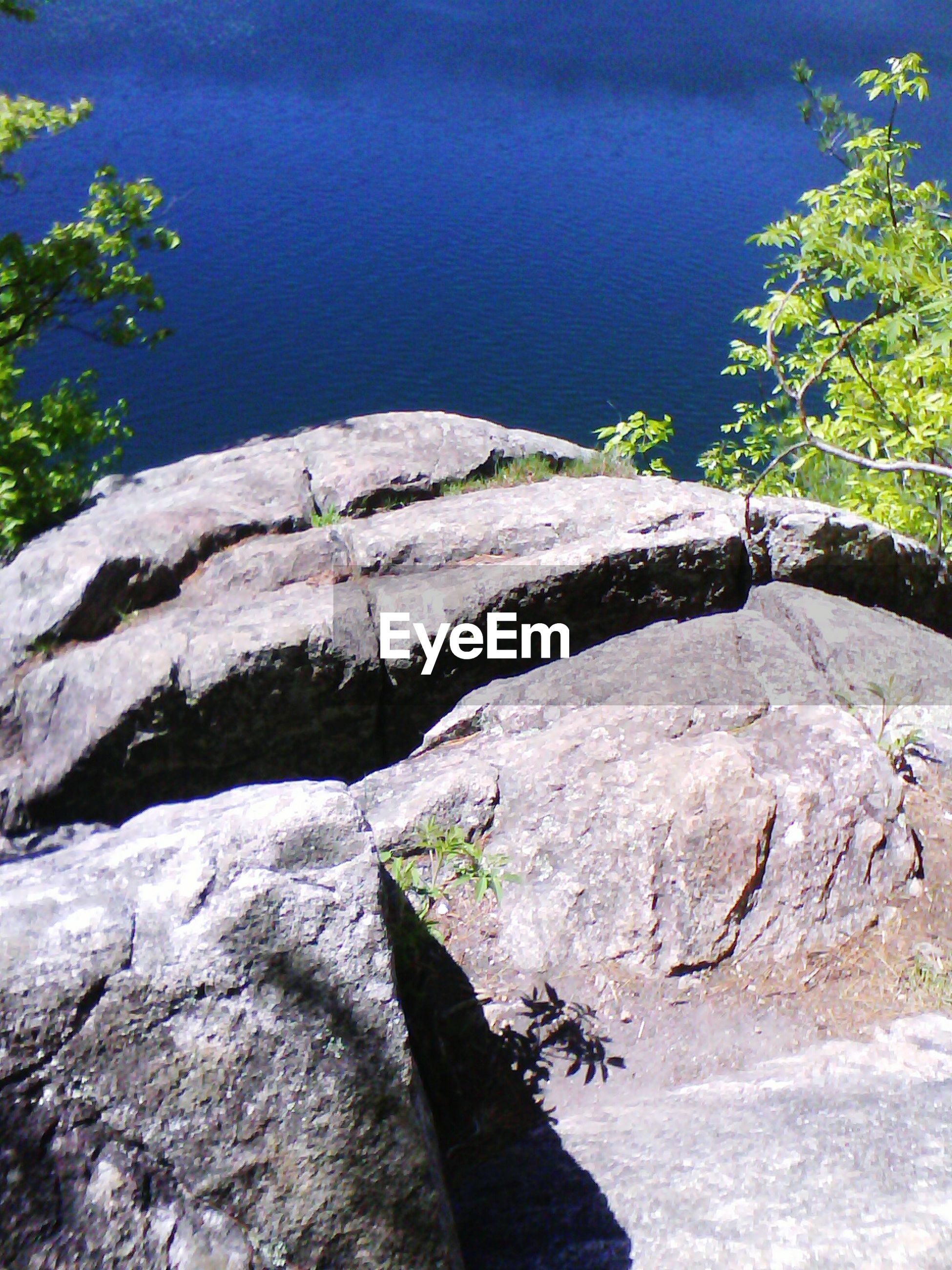 High angle view of rock against lake