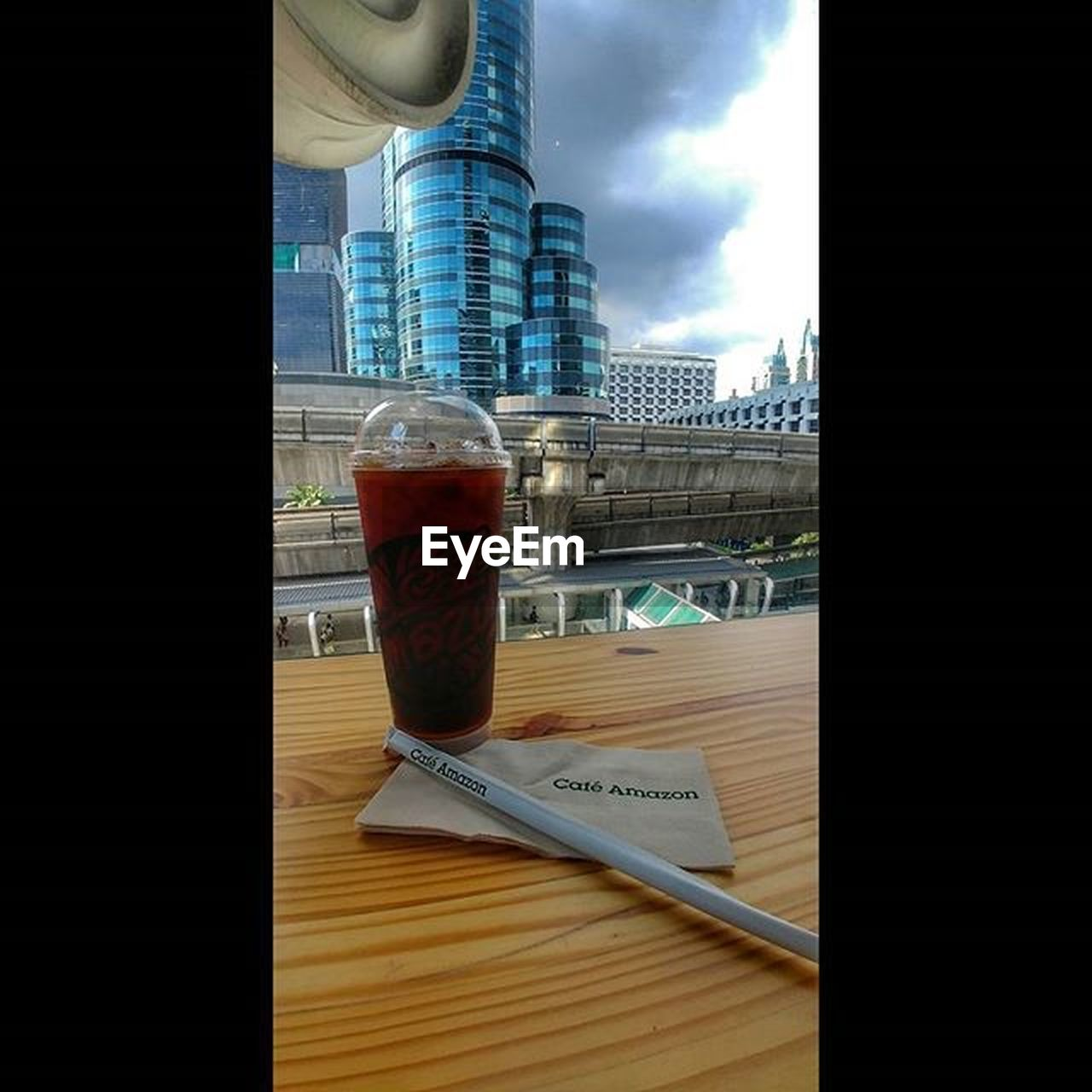 glass - material, table, refreshment, drink, window, indoors, drinking glass, built structure, building exterior, no people, architecture, skyscraper, water, day, freshness, city, sky, close-up