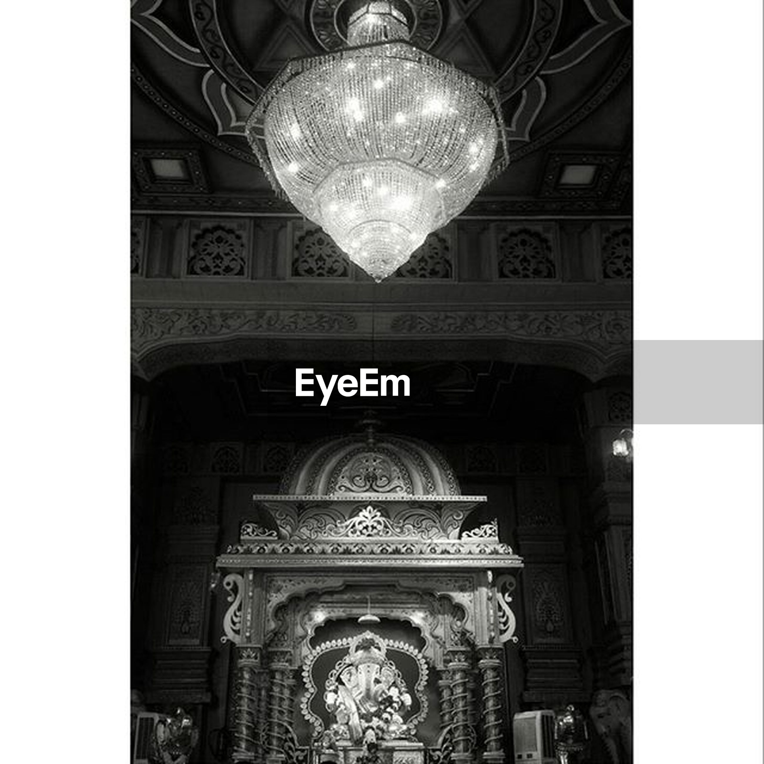 low angle view, religion, architecture, indoors, art and craft, church, ornate, art, human representation, built structure, transfer print, spirituality, place of worship, statue, creativity, sculpture, carving - craft product