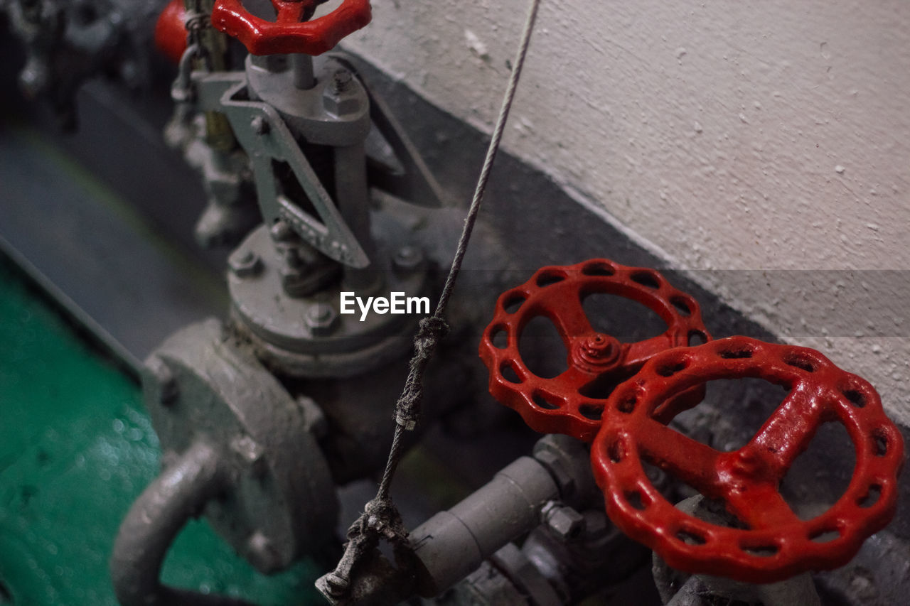 High angle view of red valves in ferry
