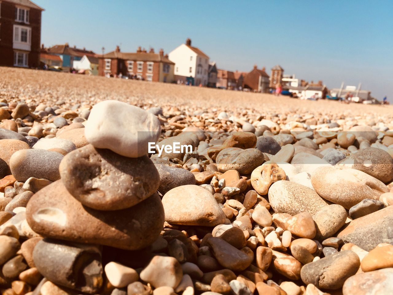 rock, solid, architecture, built structure, stone, building exterior, stone - object, sunlight, pebble, sky, land, nature, day, rock - object, focus on foreground, beach, no people, close-up, building, abundance, outdoors, surface level, gravel