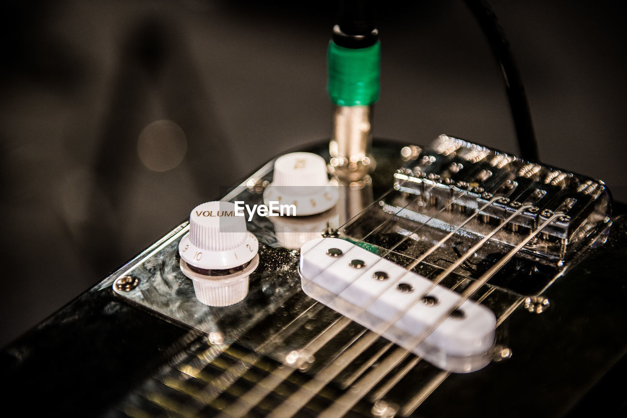 Close-Up Of Guitar By Knobs