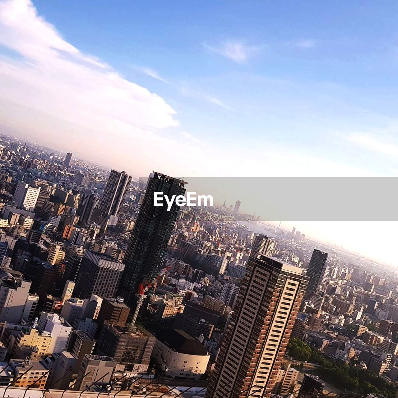 cityscape, architecture, skyscraper, city, building exterior, modern, built structure, skyline, high angle view, no people, travel destinations, city life, outdoors, day, urban skyline, sunlight, sky, aerial view, tall, downtown
