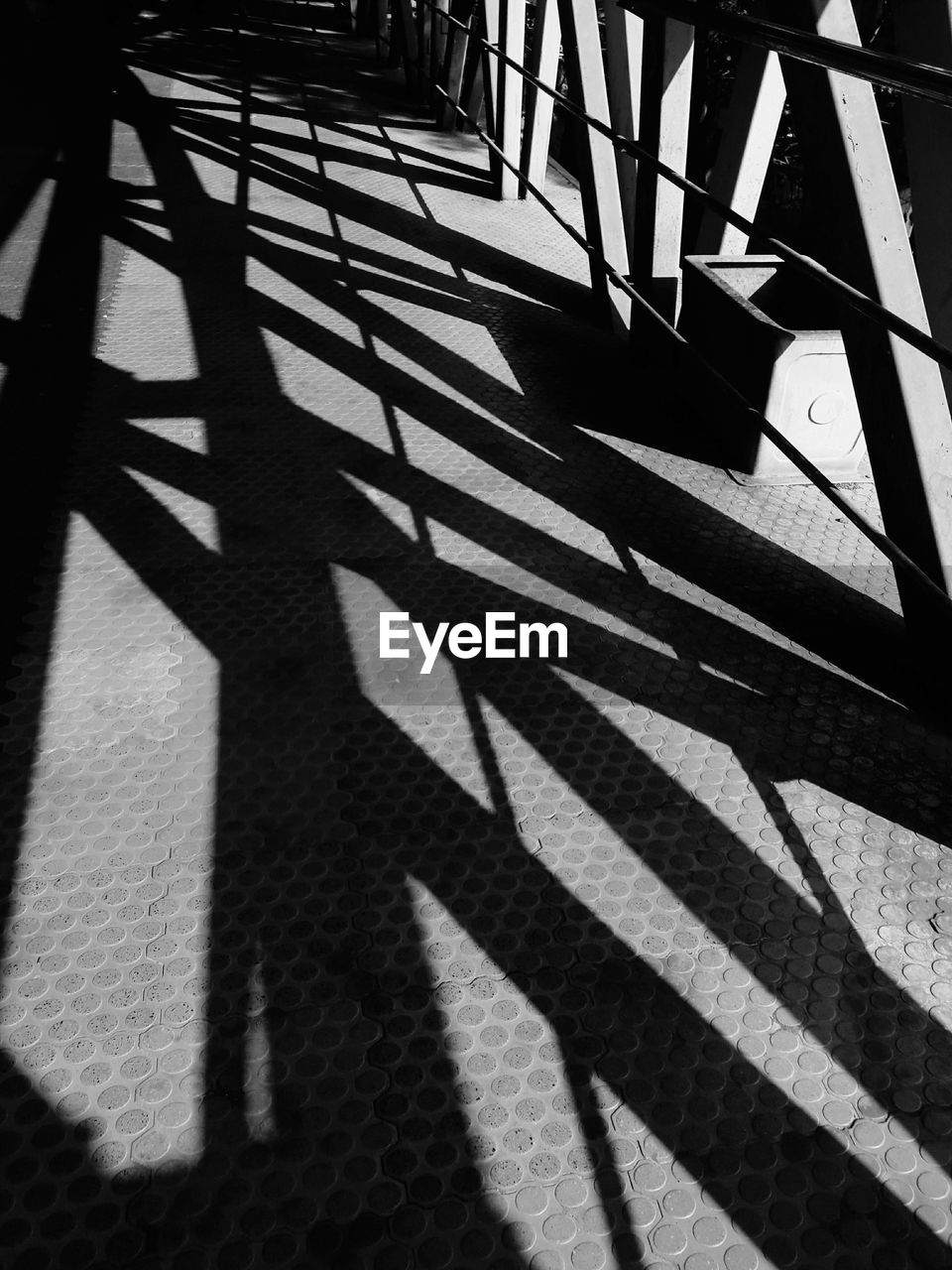shadow, sunlight, focus on shadow, day, sunny, high angle view, no people, outdoors, close-up