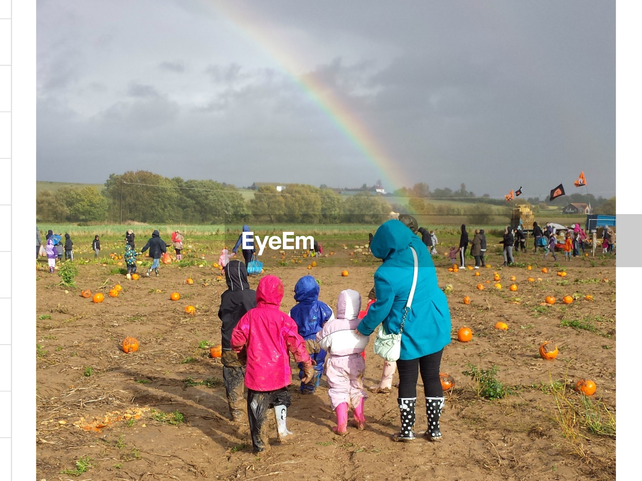Group of people on pumpkin field