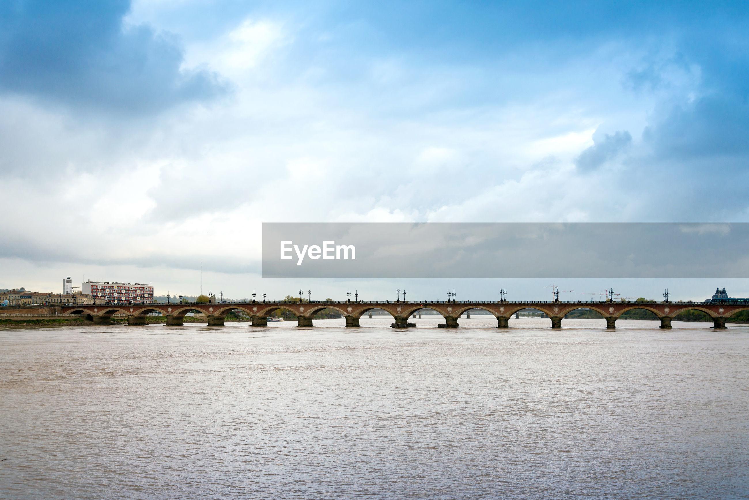 Pont de pierre over garonne river against sky