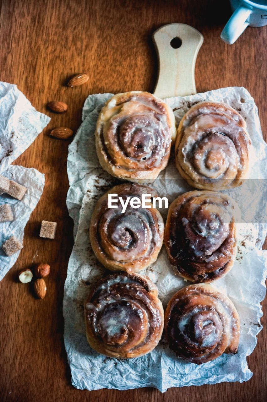 food and drink, food, freshness, wood - material, indoors, no people, close-up, table, directly above, sweet food, high angle view, still life, indulgence, choice, variation, baked, ready-to-eat, sweet, healthy eating, cutting board, temptation, tray