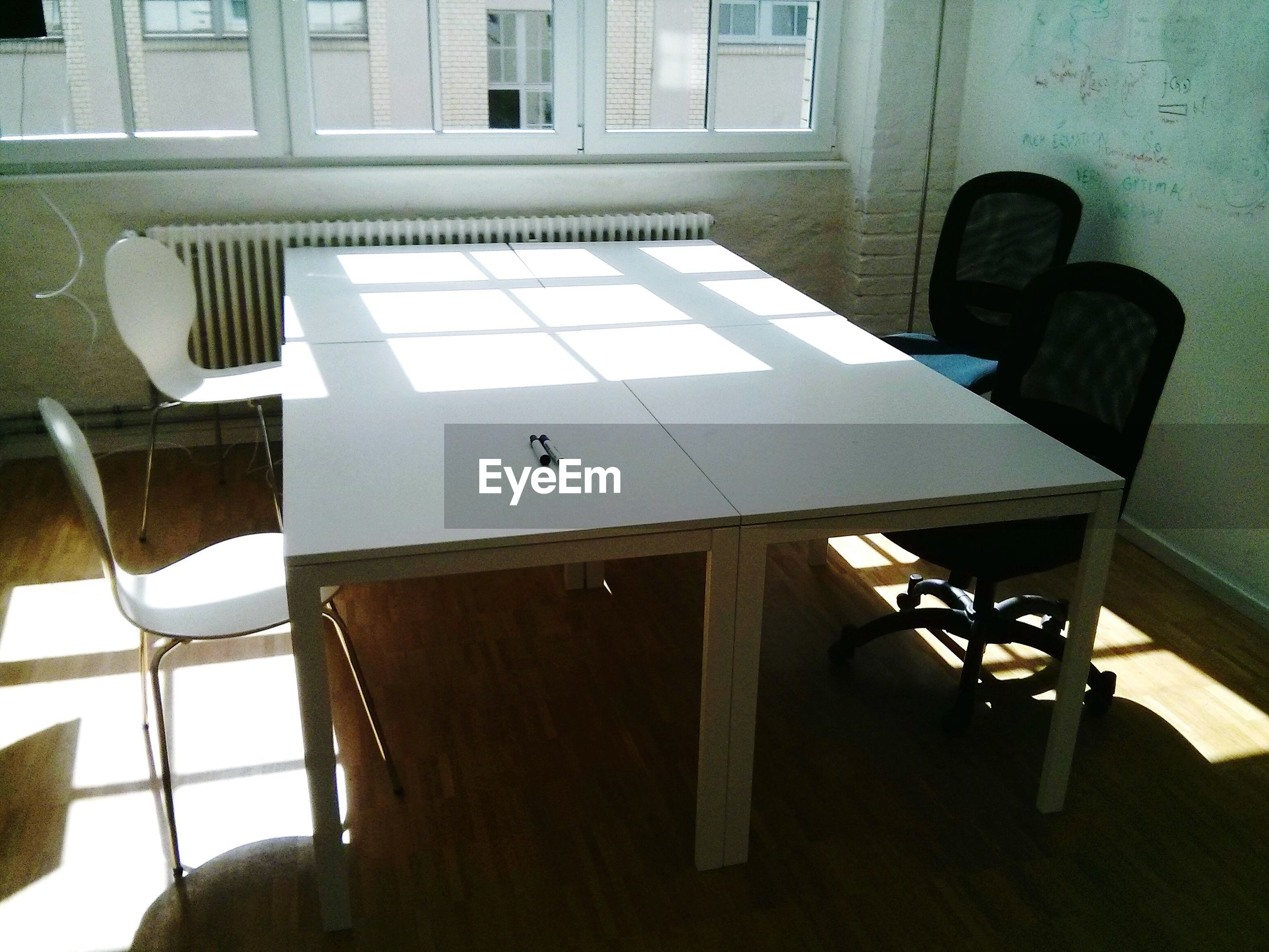 Chairs at conference table in office