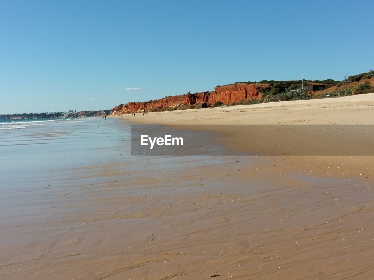 sky, land, beach, clear sky, sea, water, scenics - nature, tranquility, nature, beauty in nature, tranquil scene, copy space, sand, no people, day, blue, non-urban scene, rock, outdoors, arid climate