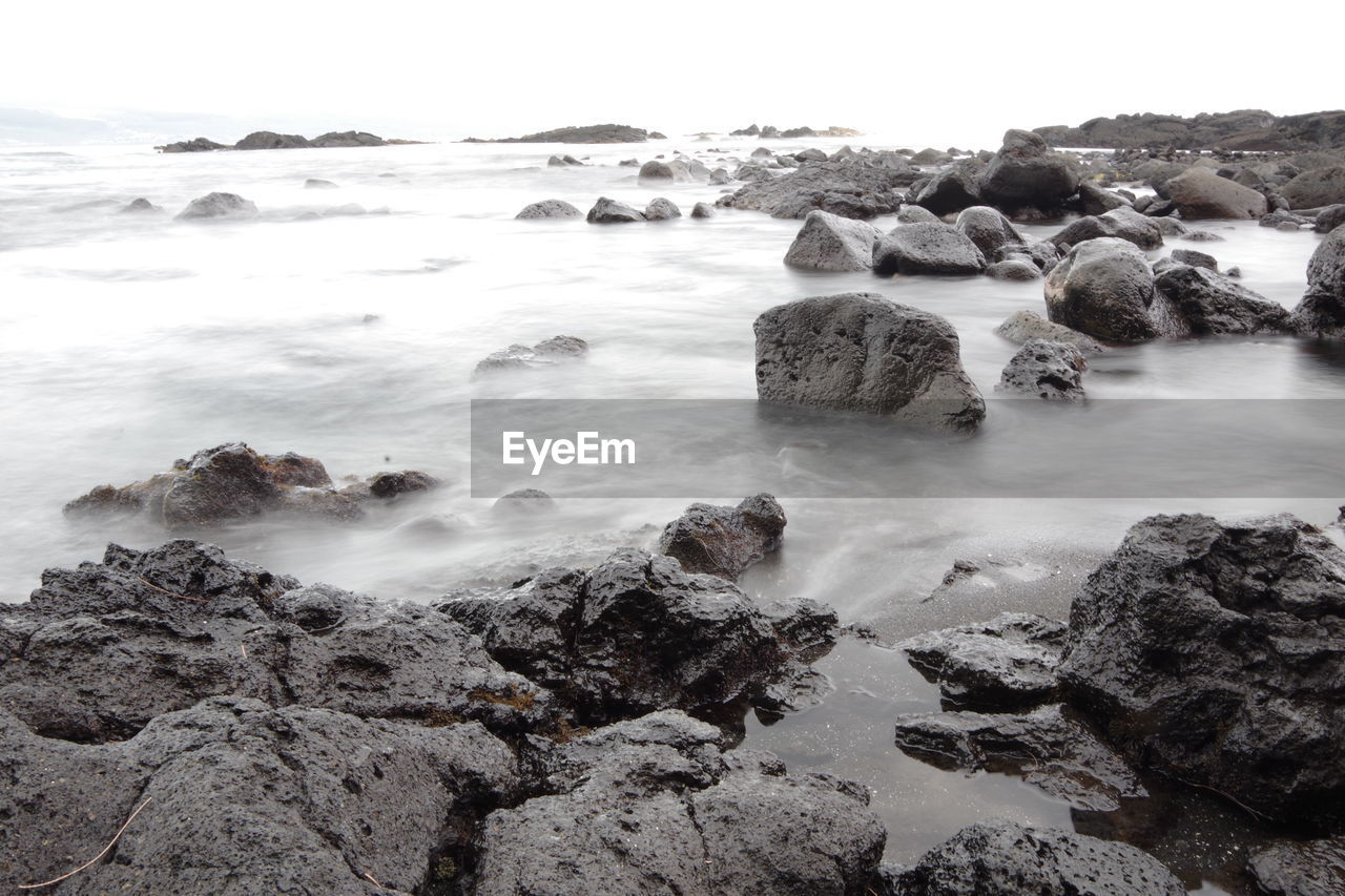 rock, water, solid, rock - object, beauty in nature, sea, sky, scenics - nature, beach, land, motion, tranquility, nature, no people, horizon over water, tranquil scene, long exposure, horizon, idyllic, outdoors, power in nature, rocky coastline