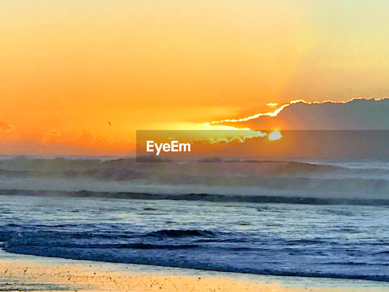 sunset, sea, sky, beauty in nature, scenics - nature, beach, water, land, orange color, wave, tranquility, idyllic, tranquil scene, motion, horizon, nature, outdoors, no people, horizon over water