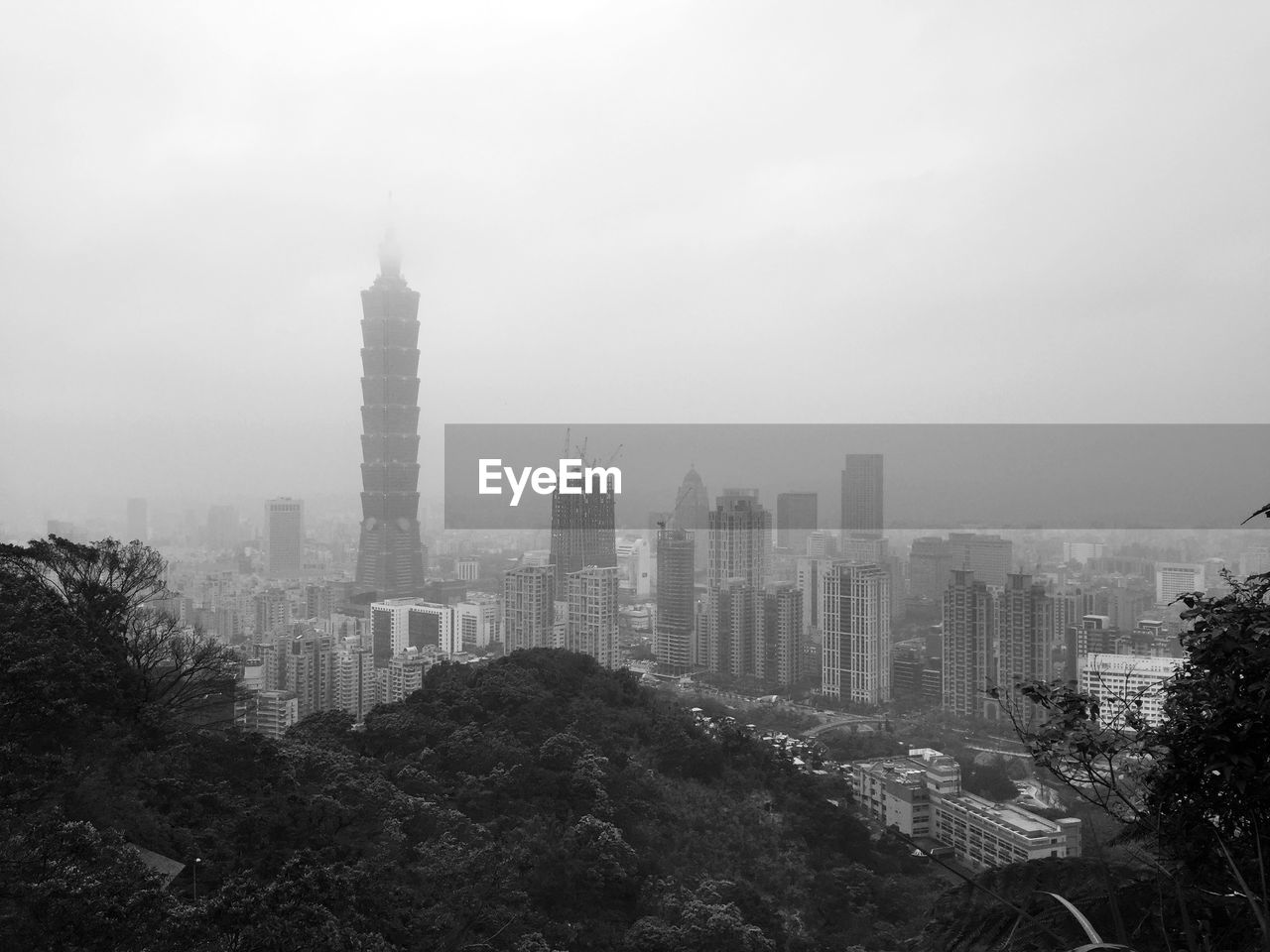 skyscraper, architecture, cityscape, city, building exterior, tower, built structure, modern, travel destinations, outdoors, fog, no people, tall, tree, day, sky, urban skyline, nature