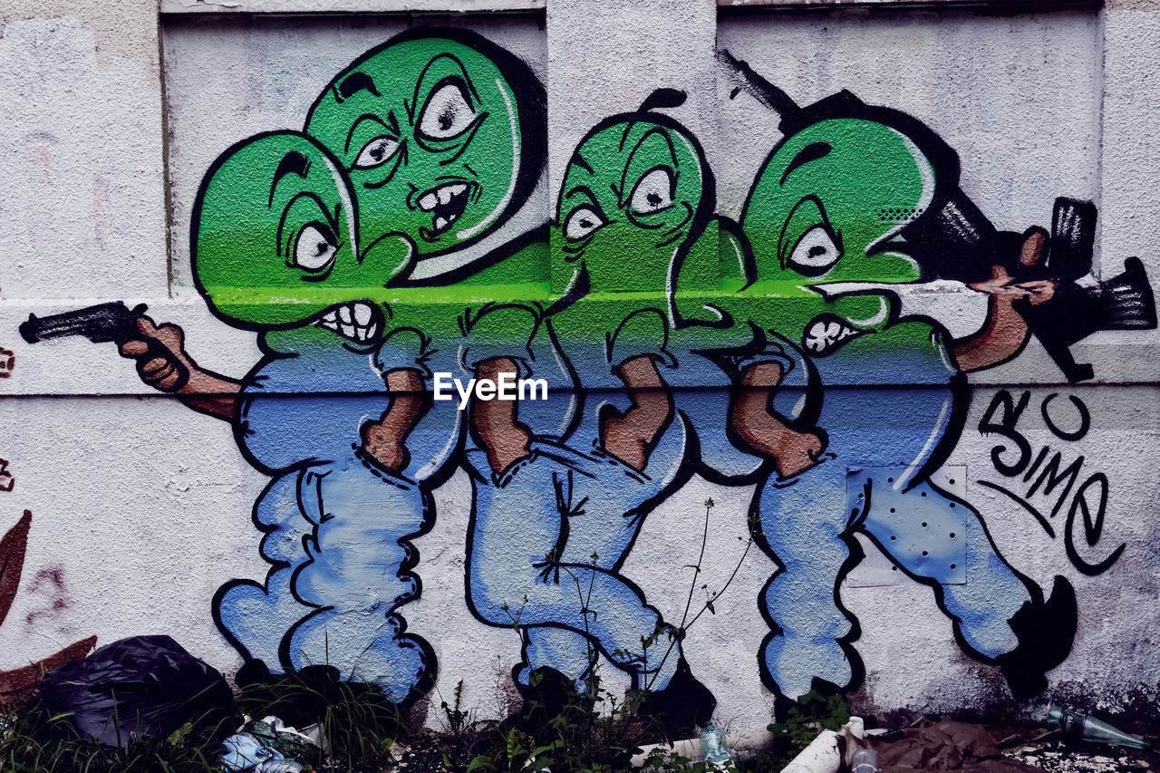 creativity, art and craft, graffiti, green color, outdoors, no people, animal representation, built structure, day, multi colored, street art, architecture, building exterior, close-up