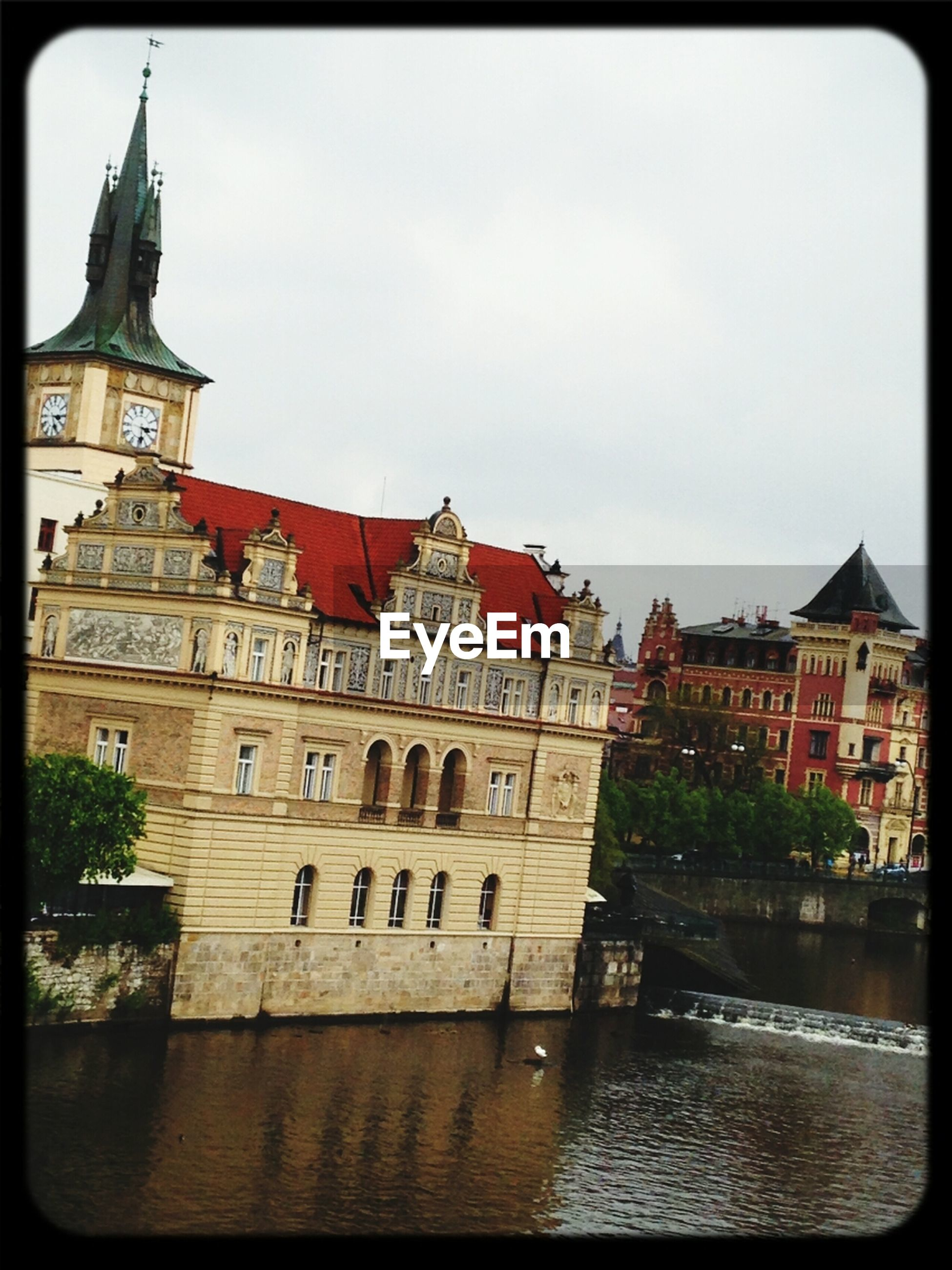 River flowing by smetana museum against clear sky
