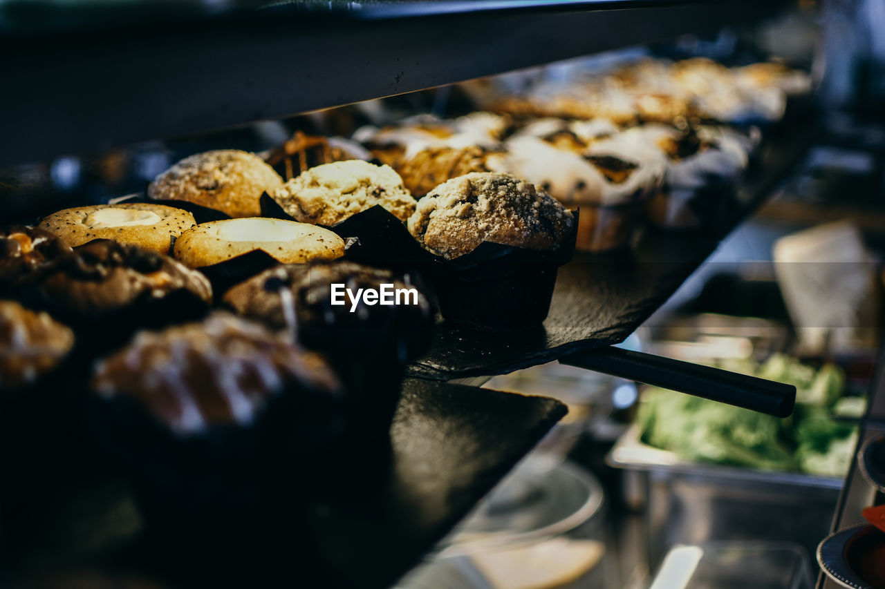 Close-up of muffins on display at store