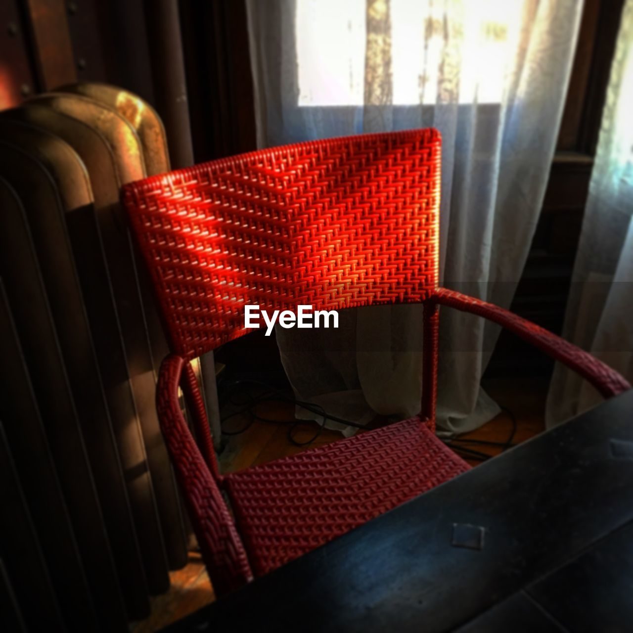 red, indoors, no people, chair, illuminated, close-up, day
