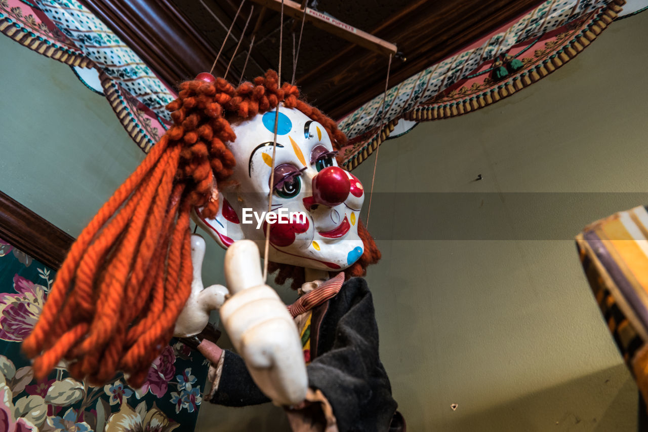 Low angle view of puppet indoors