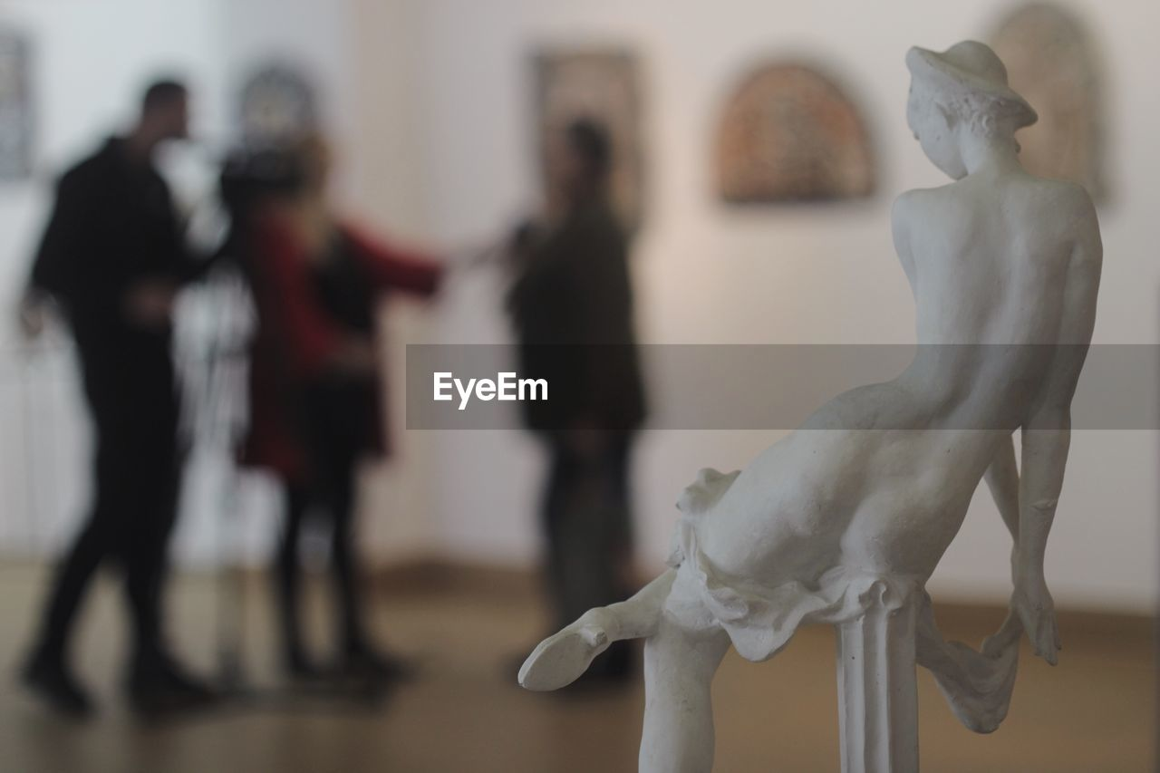 representation, art and craft, human representation, creativity, focus on foreground, indoors, sculpture, group of people, white color, museum, female likeness, male likeness, statue, women, men, adult, craft, people, arts culture and entertainment