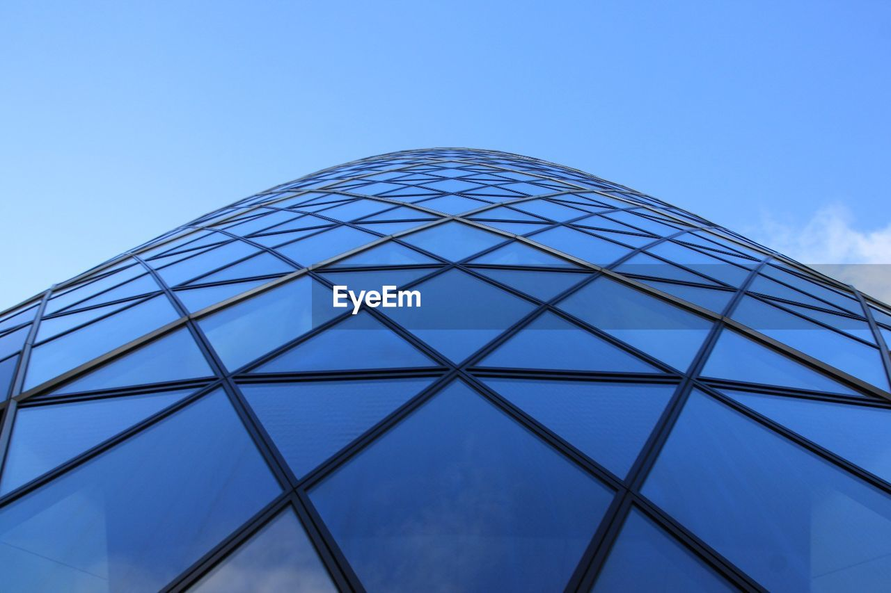 sky, low angle view, built structure, architecture, building exterior, blue, no people, glass - material, nature, modern, pattern, day, building, clear sky, office building exterior, shape, geometric shape, city, design, tower, outdoors, skyscraper, directly below
