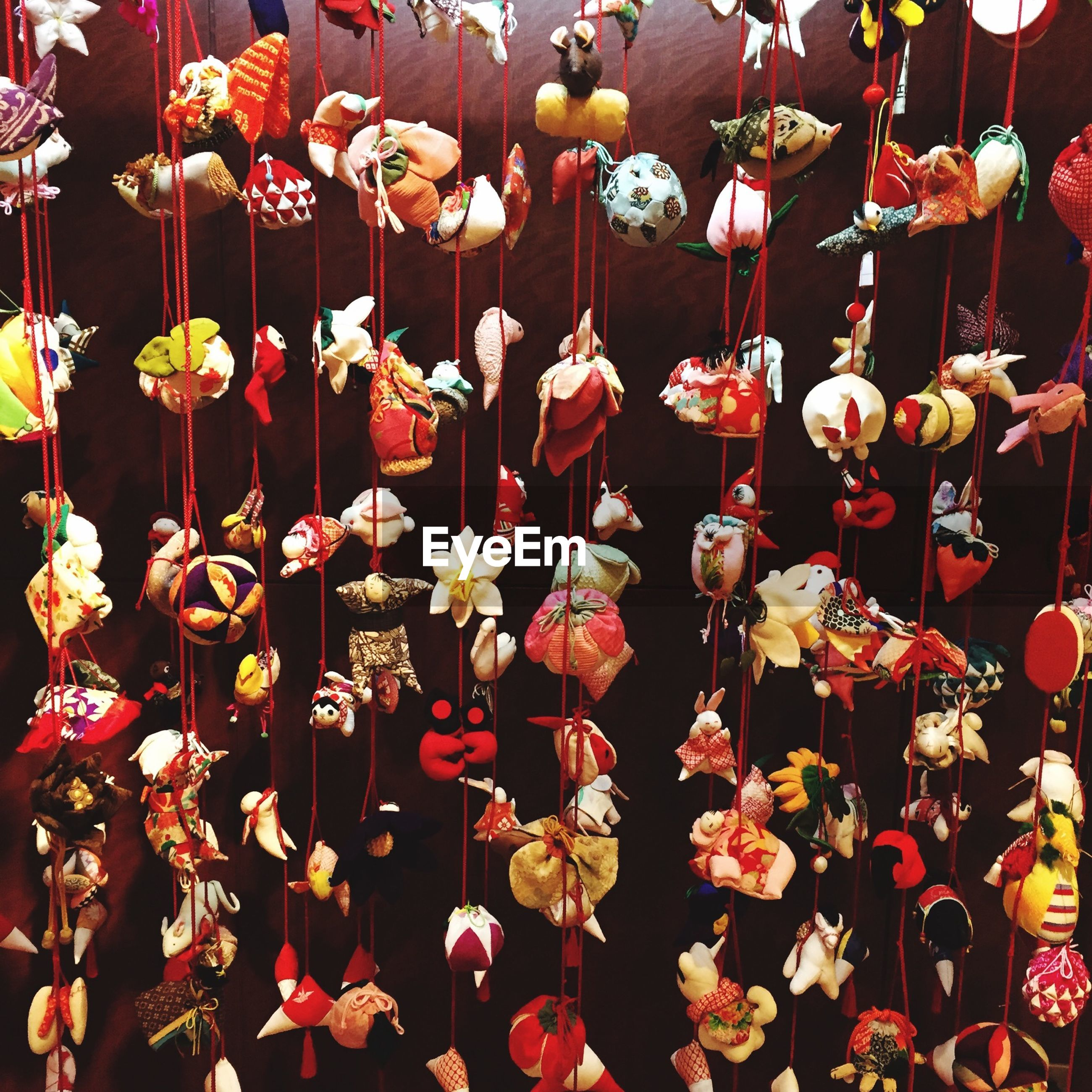 hanging, abundance, in a row, decoration, large group of objects, lighting equipment, variation, illuminated, indoors, red, arrangement, repetition, choice, multi colored, flower, low angle view, side by side, celebration, no people, lantern