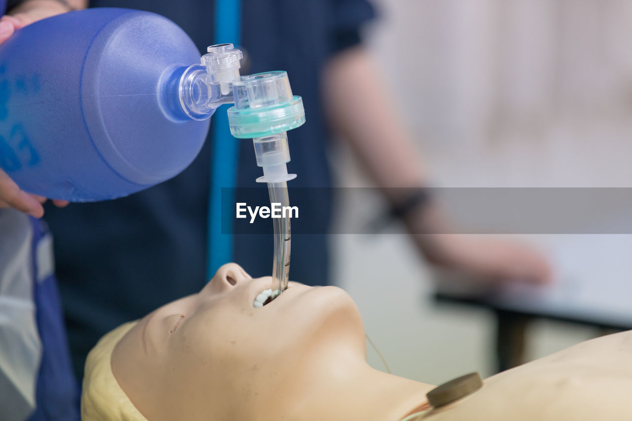 Cropped Image Of Person Learning Cpr In Hospital