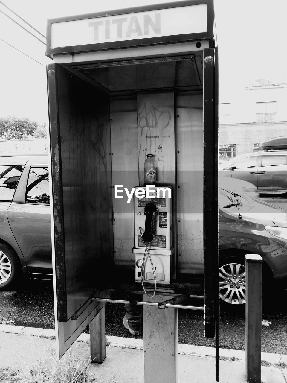 transportation, connection, pay phone, telephone booth, communication, old-fashioned, car, mode of transport, outdoors, day, telephone, technology, built structure, fuel pump, no people, architecture
