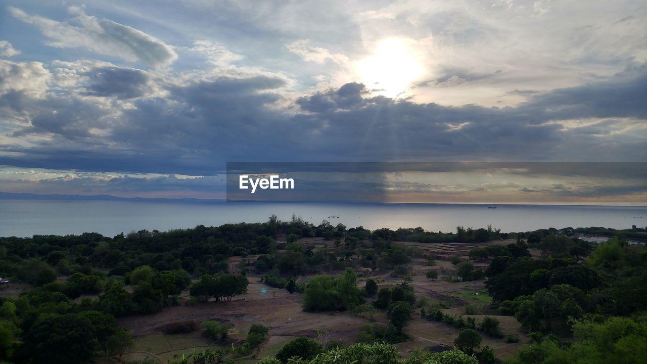 sky, cloud - sky, scenics - nature, tranquil scene, tranquility, beauty in nature, water, sea, nature, horizon, horizon over water, sunset, no people, sunbeam, non-urban scene, idyllic, sun, outdoors