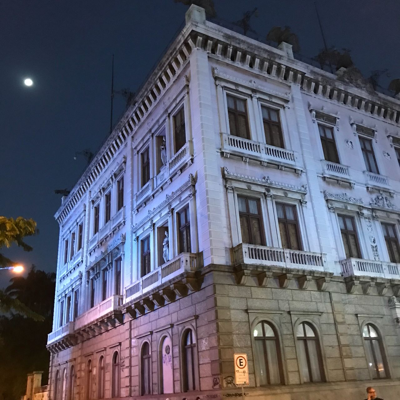 building exterior, architecture, built structure, building, illuminated, night, window, no people, city, low angle view, sky, street, outdoors, street light, nature, history, dusk, the past, moon, lighting equipment