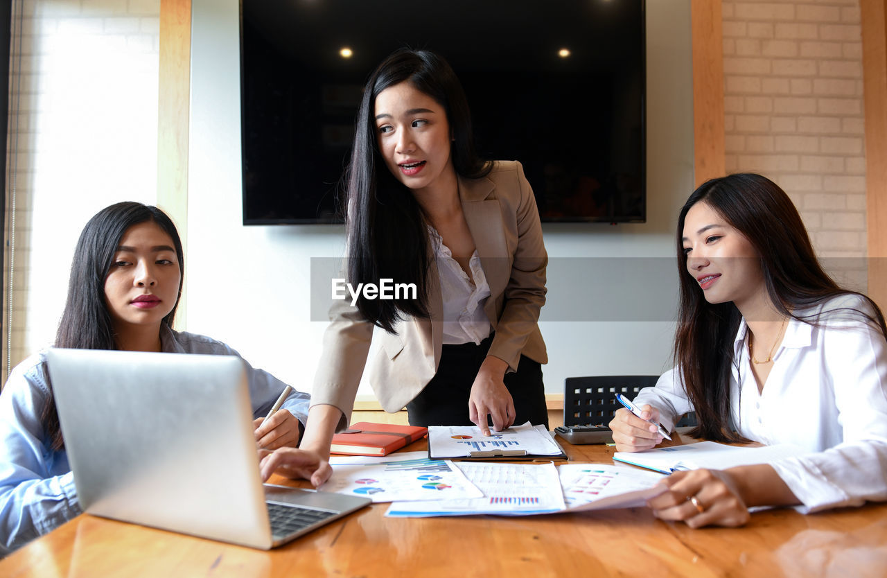 Businesswomen discussing on table