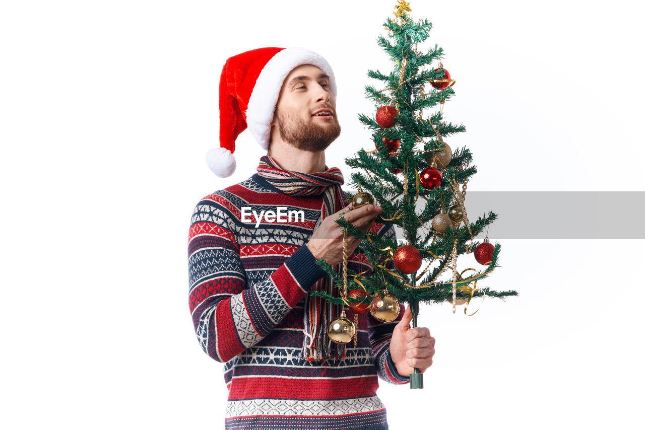 FULL LENGTH OF MAN WEARING CHRISTMAS TREE