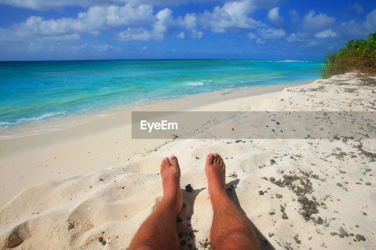 beach, sea, sky, land, low section, water, horizon over water, human leg, horizon, sand, personal perspective, nature, barefoot, human body part, beauty in nature, body part, scenics - nature, real people, cloud - sky, day, human foot, outdoors