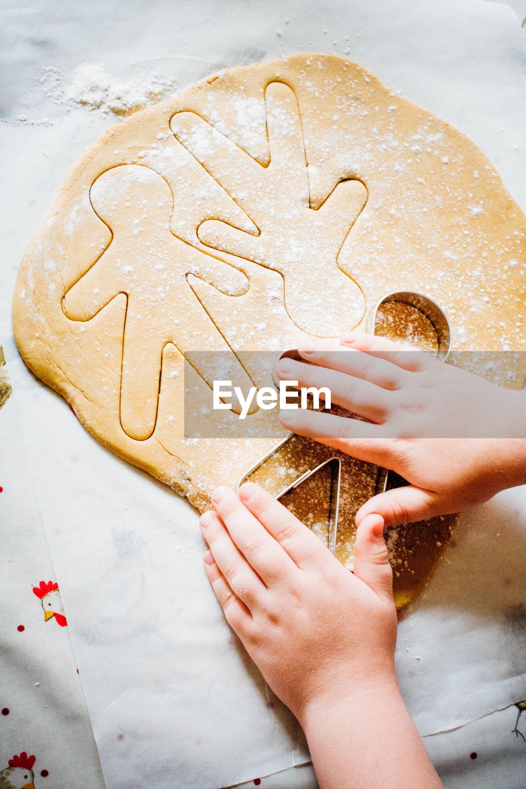 Child making gingerbread men