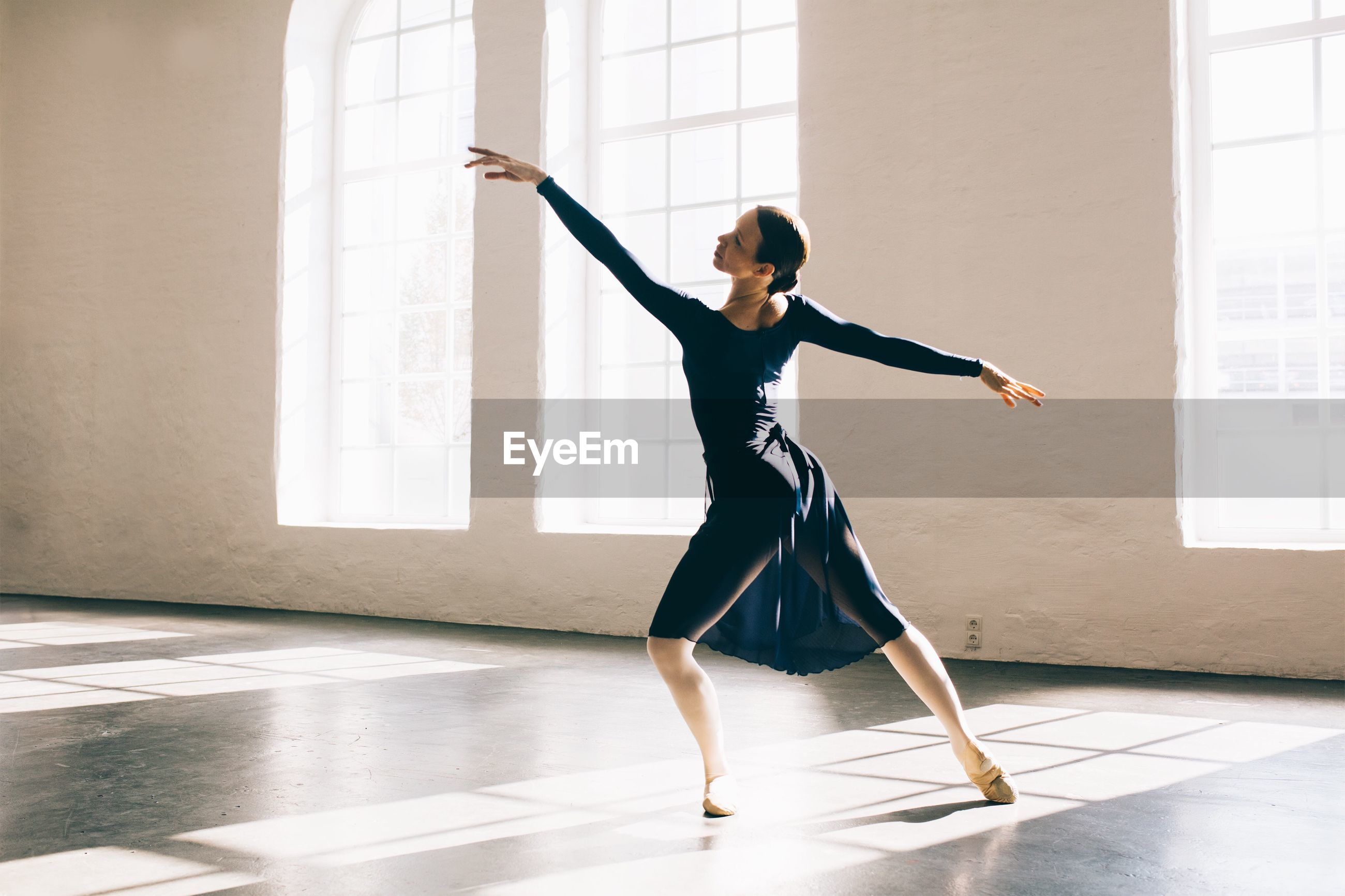 skill, real people, dancing, indoors, practicing, one person, full length, balance, leisure activity, lifestyles, expertise, dancer, ballet, women, ballet dancer, performance, standing, young women, young adult, day, architecture, people