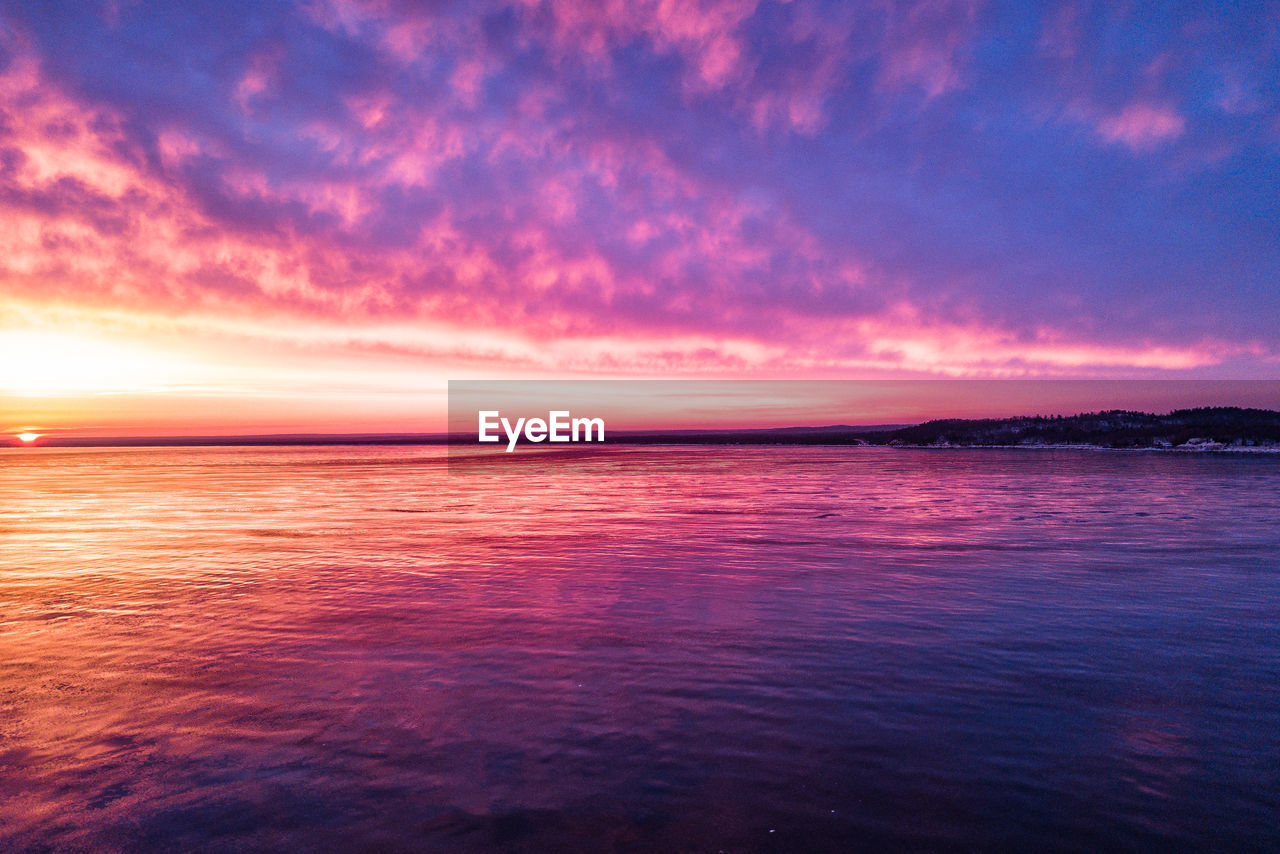 scenics, beauty in nature, sunset, sea, tranquility, tranquil scene, sky, nature, cloud - sky, water, idyllic, dramatic sky, outdoors, no people, horizon over water, waterfront, day