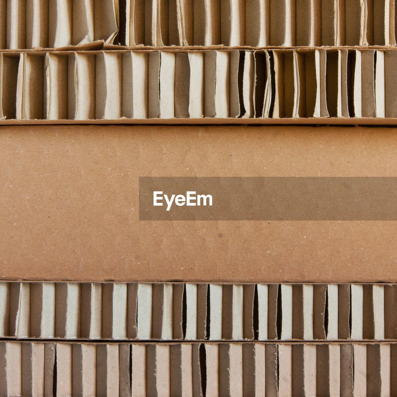 FULL FRAME SHOT OF PIPES IN BOX