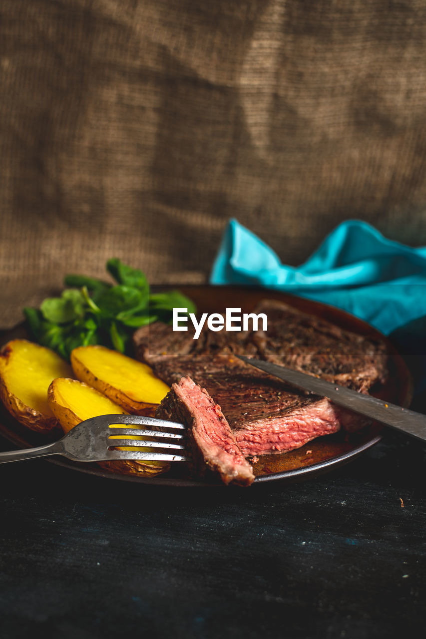 food, food and drink, freshness, meat, vegetable, plate, red meat, table, still life, indoors, ready-to-eat, healthy eating, beef, no people, close-up, kitchen utensil, steak, grilled, fork, wellbeing, temptation, breakfast