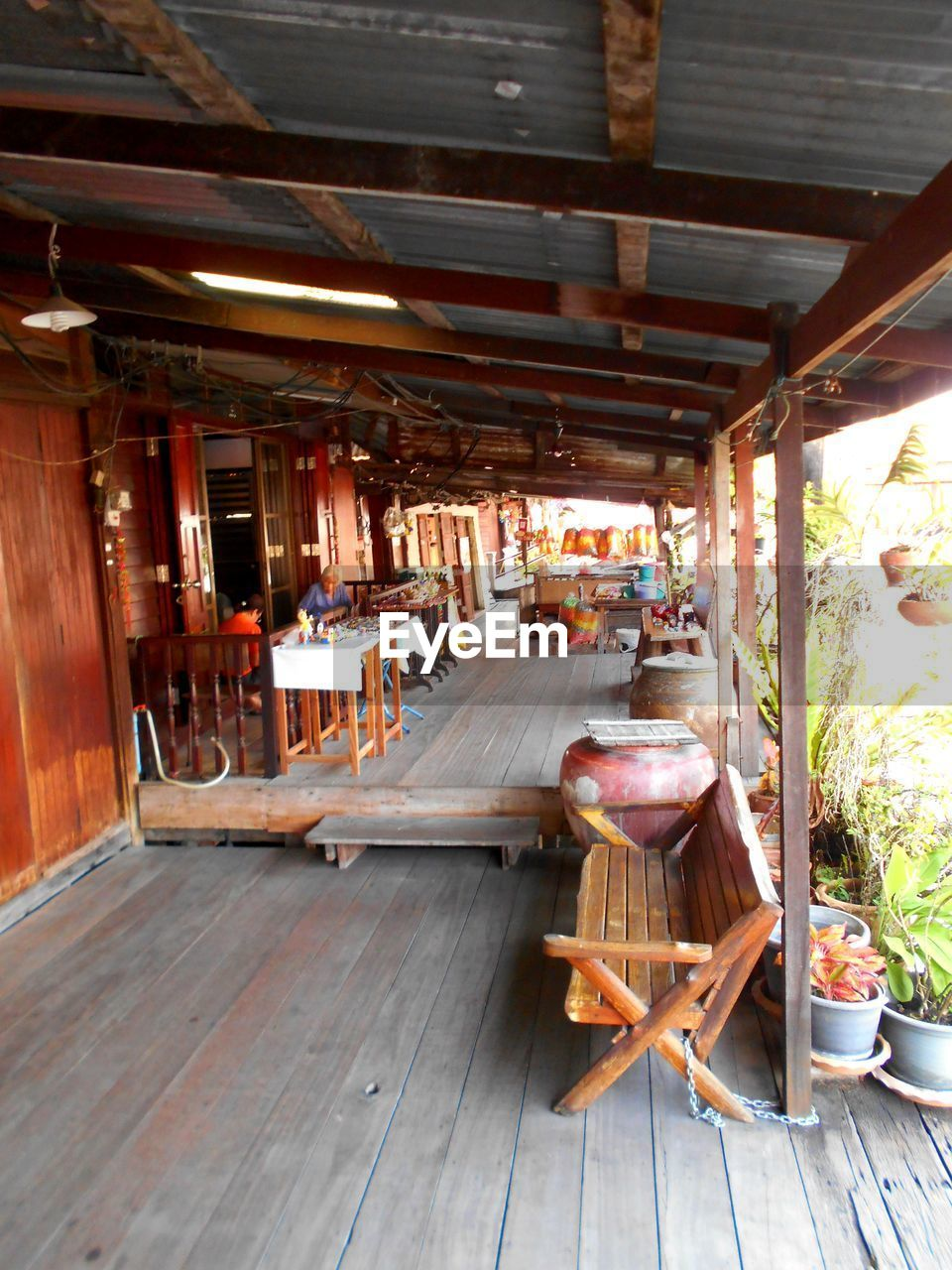 wood - material, architecture, no people, day, table, built structure, food and drink, indoors, restaurant, wood, seat, transportation, nature, business, porch, sunlight, mode of transportation, building